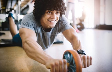 Photo for Fit healthy man exercising in modern gym - Royalty Free Image
