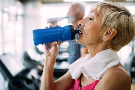 Photo for Image of attractive fit mature woman in gym - Royalty Free Image