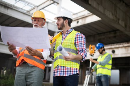 Photo for Engineer, foreman and worker discussing and working in building construction site - Royalty Free Image