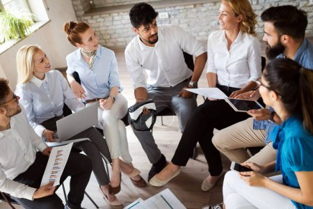 Photo for Group of young business professionals having a meeting. Diverse group of young designers smiling during a meeting at the office. - Royalty Free Image