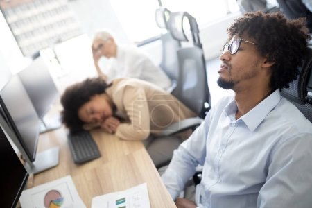 Photo for Overworking concept. Group of business people exhausted sleep in office - Royalty Free Image