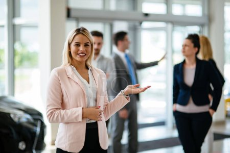 Photo for Picture of professional female salesperson working in car dealership - Royalty Free Image