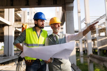 Photo for Group of construction engineer working in construction site and management in the construction site - Royalty Free Image