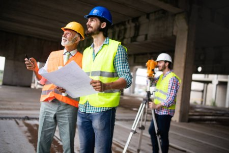 Photo for Construction engineer architect with foreman worker checking construction site - Royalty Free Image