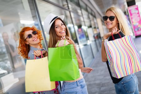Photo for Sale and tourism, happy people concept. Beautiful women with shopping bags in the ctiy - Royalty Free Image