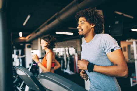 Photo for Teamwork in gym. Couple working exercise together. Healthy life concept - Royalty Free Image