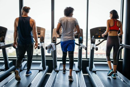 Photo for Healthy young athletes people doing exercises at gym. - Royalty Free Image