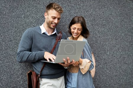 Photo for Happy woman and man using laptop outdoor. Travel, business, technology, people fun concept - Royalty Free Image