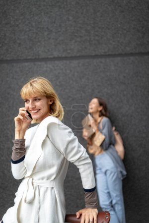 Photo for Portrait of a smiling beautiful woman with phone, smartphone. Technology, people, device concept - Royalty Free Image