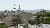 Scenic view of the circa two thousand years old pyramid called Huaca Huallamarca located in San Isidro district of Lima surrounded by modern buildings and houses