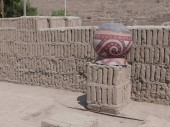 Inverted clay vase placed on a column of vertical bricks in the Huaca Pucllana administrative sector located in Miraflores district of Lima