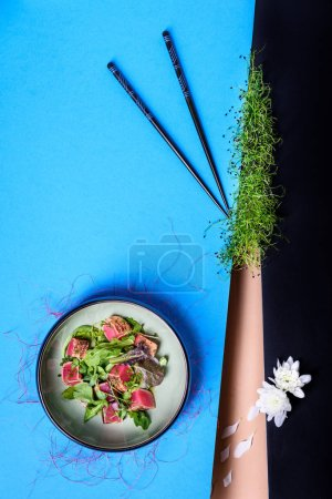 Photo for Grilled tuna salad with microgreens and sprouts. Healthy eating concept. Hawaiian tuna poke bowl. Top view, copy space. - Royalty Free Image