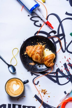 Photo for Freshly baked croissant with coffee  for breakfast. Messy style background. Top view, copy space.The Art of food. - Royalty Free Image