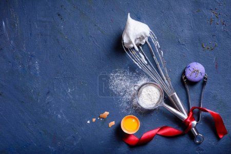 Photo for Bakery background frame. Fresh cooking ingredients - egg, flour, sugar, over blue background. Spring cooking theme. Top view, copy space. - Royalty Free Image