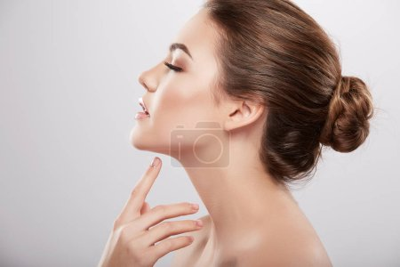 beauty portrait of young woman posing at grey background,  skin care and hydrated skin, concept