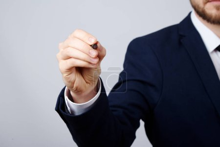 cropped photo of businessman in black suit showing hand