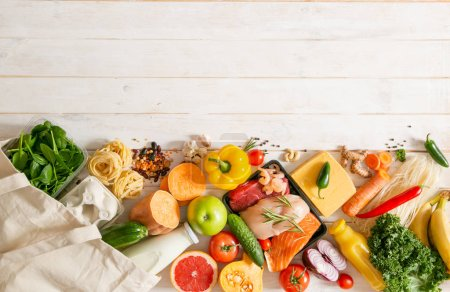 Photo for Balanced diet concept - fresh meat, fish, pasta, fruits and vegetables, nuts, seeds copy space - Royalty Free Image