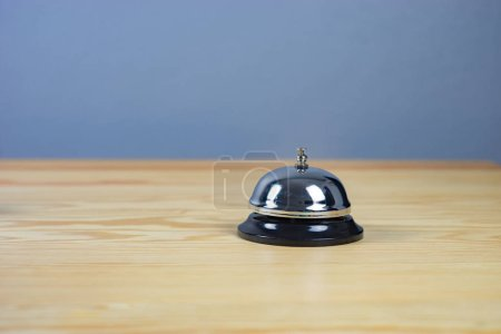 Photo for Close up on silver service bell on wooden table - Royalty Free Image