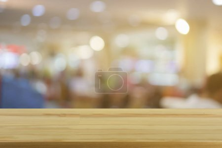 Empty brown wooden table at Coffee shop with blur background with bokeh lights