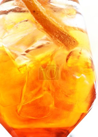 Photo for Glass with refreshing juice at the bar. Citrus cocktail over ice, orange cocktail details - Royalty Free Image