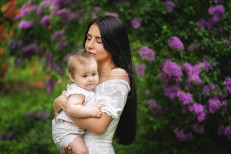 Photo for Genuine mother holding a baby, Mother's day. - Royalty Free Image