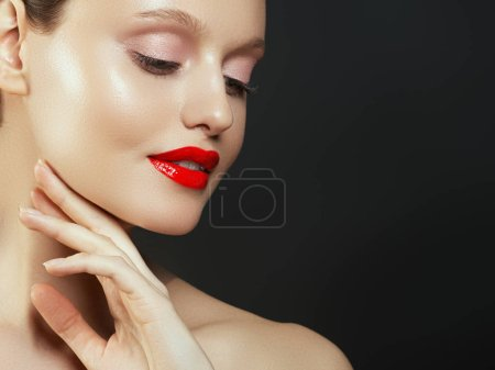 Photo for Makeup, cosmetics. Beauty young woman portrait. Beautiful model girl with beauty makeup, red lips, perfect fresh skin. Attractive lady with green eyes. Youth and Skin Care Concept - Royalty Free Image