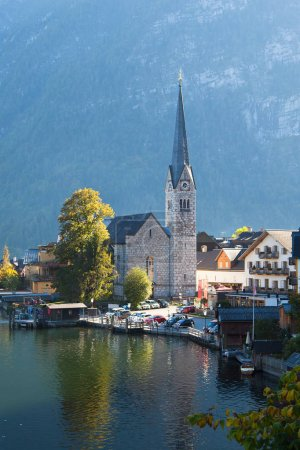 Photo for Reflection of mountain village in Hallstatter See, Austria - Royalty Free Image