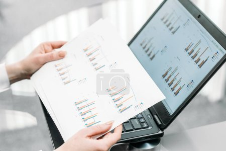 Photo for Business documents graphs. laptop hands holding papers. report statistics data analysis. office workplace - Royalty Free Image