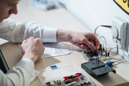 Photo for Smart home system. technology development for efficient use of resources. engineer assembling electronic components - Royalty Free Image