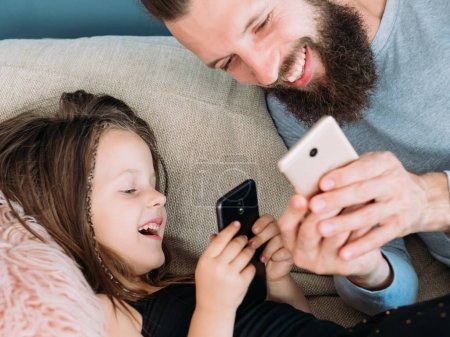 happy family leisure dad kid laugh together phone