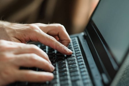 Photo for Freelance work or remote job concept. man hands typing on laptop keyboard. - Royalty Free Image
