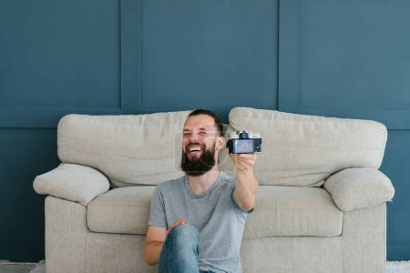 Photo for Blogger streaming. bearded hipster man laughing while recording video for subscribers using camera. new modern technology concept. - Royalty Free Image