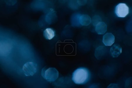 Photo for Abstract lens flare on black background. blue defocused bokeh lights. glowing color burst. festive christmas backdrop. blurred flying snowflackes concept. - Royalty Free Image