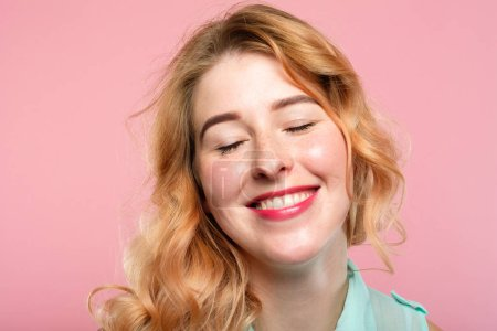 Photo for Emotion expression. very happy joyful thrilled to bits woman with beaming smile. young beautiful blond girl portrait on pink background. - Royalty Free Image