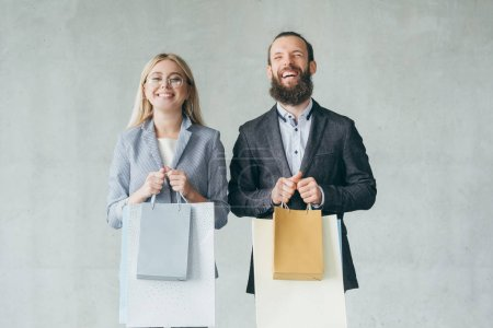 Photo for Shopping therapy makes you happy. delighted smiling couple holding bags with purchases. - Royalty Free Image