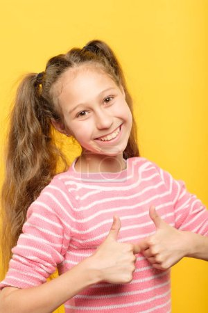 Photo for Thumbs up. good job. like and approval concept. enthusiastic motivated girl showing gesture. - Royalty Free Image