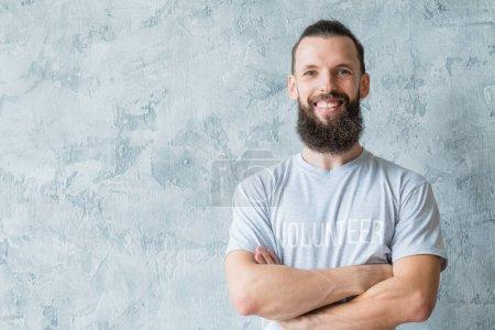 man volunteer t-shirt smile participation altruism