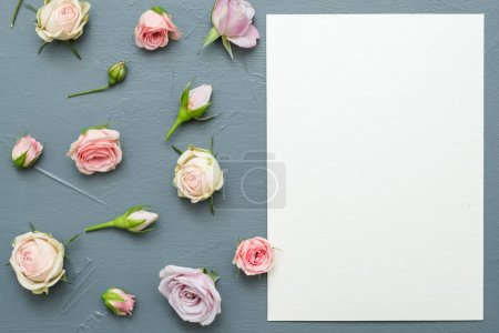 Photo for Greeting card mockup. Congratulation concept. Assorted flowers on grey background. Flat lay. - Royalty Free Image
