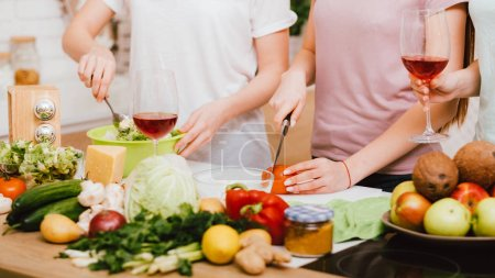 Photo for Friends dieting together. Healthy eating lifestyle. Females cooking leisure. - Royalty Free Image