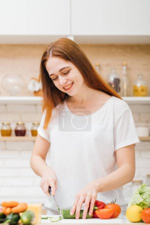 Photo for Love cooking. Healthy eating habit. Leisure and lifestyle. Smiling young woman chopping vegetables for salad. - Royalty Free Image