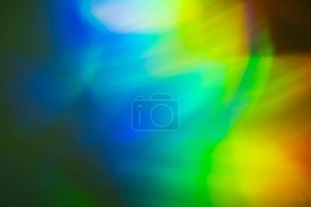 Photo for Defocused blue and yellow lights on dark background. Bokeh lens flare glow optical effect. - Royalty Free Image