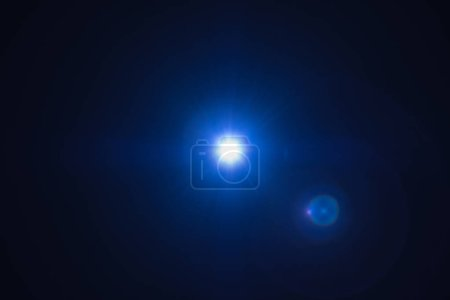 Photo for Blue flash spark on black background. Lens flare effect. Defocused spotlight glow - Royalty Free Image