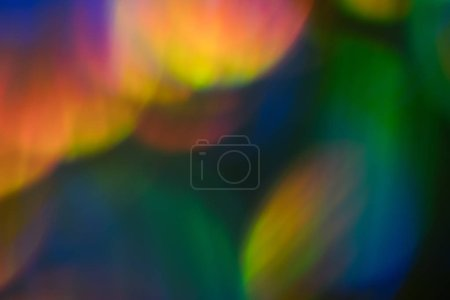 Photo for Blur colorful lens flare spots. Defocused abstract background. Bokeh Illuminated glow. - Royalty Free Image