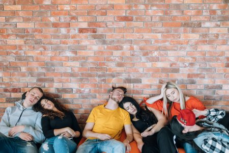 Photo for Productive meeting. Exhaustion. Tired business team sleeping on bean bags. Millennial culture. Creativity and freedom. - Royalty Free Image