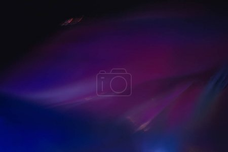 Photo for Blurred neon multicolor abstract lines on dark background. Defocused lens flare glow effect. - Royalty Free Image