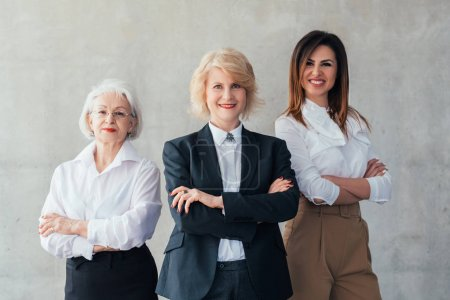 Photo for Successful business women. Professional career. Confident mature and young ladies standing with arms folded, smiling. - Royalty Free Image