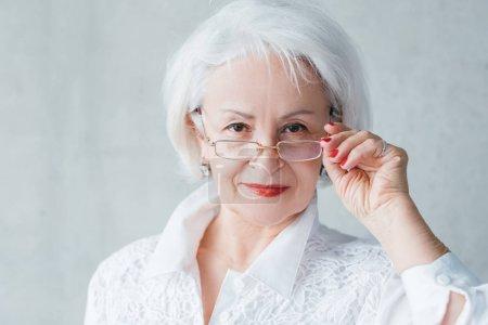 senior business woman evaluative self assured lady
