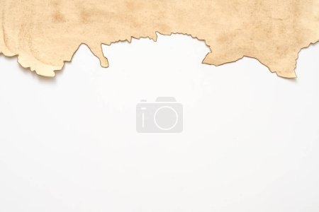 Photo for Aged beige paper with burnt edge on white background. Grunge abstract design. Copy space. - Royalty Free Image
