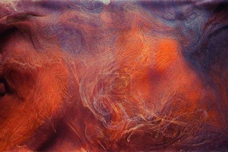 Photo pour Fuite de fumée. Energie enchantée. Purple orange paillettes vapeur abstraite. Art créatif fond . - image libre de droit