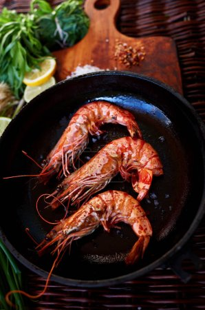 Young married couple has prepared a romantic light dinner of prawn